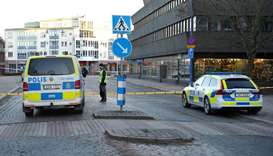 Police gather at the knife attack site in Vetlanda, Sweden
