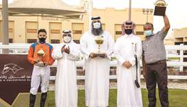 Qatar Racing and Equestrian Club Racing manager Abdulla Rashid al-Kubaisi with the winners of the Lo