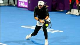 Victoria Azarenka of Belarus in action during the Qatar Total Open quarter-final against Elina Svito