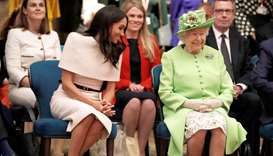 Britain's Queen Elizabeth II and Meghan, Duchess of Sussex gesture during their visit to the Storyho