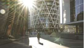 A lone pedestrian walks through the Porta Nuova business district in Milan. Surging ethical debt sal