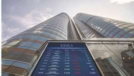 A screen displays stock figures outside the Hong Kong Stock Exchange. The Hang Seng index closed dow
