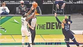 Jrue Holiday of the Milwaukee Bucks shoots the game winning shot against Dillon Brooks of the Memphi