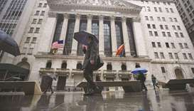 Pedestrians walk past the New York Stock Exchange. As US technology shares stumble, investors are de