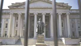 A statue of Albert Gallatin, former US Treasury secretary, stands outside the Treasury building in W