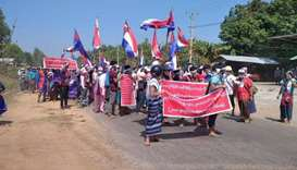 Protesters hold placards during the ant-coup protest in Hpapun Township, Kayin State, Myanmar