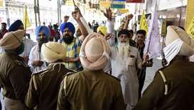 Punjab Police personnel stop farmers protesting against the central government's recent agricultural