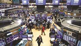 Traders work on the floor of the New York Stock Exchange (file). Traders across Wall Street are pois