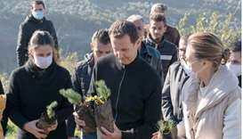 Syria's President Bashar al-Assad and his wife Asma, plant trees in city of Draykish, near Tartous,