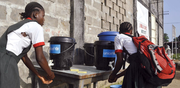 A girl wash her hands at a school in Paynesville, Liberia.