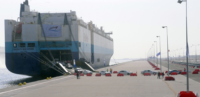 New vehicles are unloaded from a ship at the Hamad Port