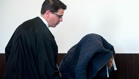 Defendant Tufik M (R) arrives with his lawyer Markus Wittke (L) at the court in Duesseldorf