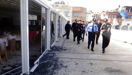 Security personal inspects a hotel premises in Kilis where a from Syria has fallen.