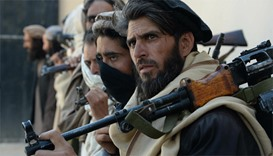 Afghan Taliban fighters close in on provincial city