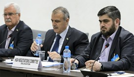 Members of the Syrian opposition delegation of the High Negotiations Committee (HNC)