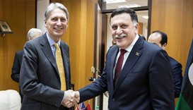 Fayez al-Sarraj, prime minister of the UN-backed unity government (R) meeting with British Foreign S