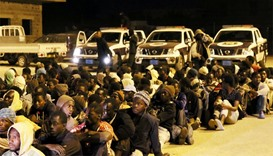 Libyan security forces detain illegal migrants, who wanted to cross the Mediterranean to Europe, dur
