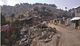 A year after quake, billions unspent and little rebuilt