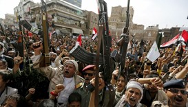 Armed Houthi followers rally against Saudi-led air strikes in Sanaa, Yemen