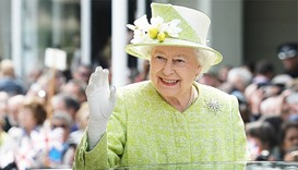 Britain's Queen Elizabeth II waves to wellwishers during a 'walkabout' on her 90th birthday