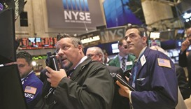 Wall Street investors brace for more corporate earnings