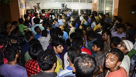 Bangladeshi journalists and onlookers where the activist was allegedly hacked to death