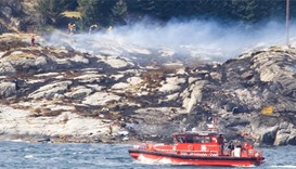 Rescue forces work at the shore west of Bergen, Norway after a helicopter crash