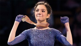 Gold medalist Evgenia Medvedeva of Russia celebrates during the victory ceremony
