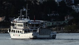 A small Turkish ferry carries migrants who are deported to Turkey from the port of Mytilene