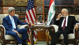 Kerry vows to up pressure on IS during Iraq visit