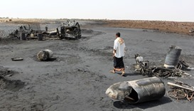 A man walks at the site of a crude oil pipeline explosion and fire near the Red Sea port of Hodeidah
