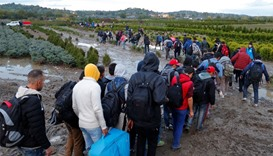 Migrants make their way after crossing the border at Zakany, Hungary