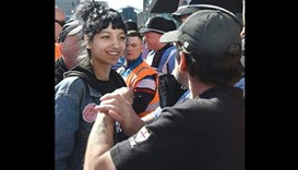 Woman stares down EDL protester at rally