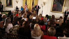 US President Donald Trump speaks at the East Room of the White House
