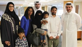 Osman and his family with Sidra officials.