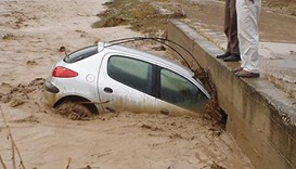 Torrential rains lashed East Azerbaijan province, with state television showing images of rivers bur