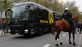 Borussia Dortmund's team bus arrives for the UEFA Champions League 1st leg quarter-final football ma