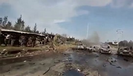 Videograb shows burnt out buses on road, scattered debris in Aleppo