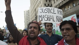Pakistani activists shout slogans  against the killing of student Mashal Khan
