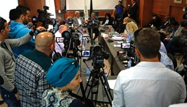 Palestinian Authority official Issa Qaraqee (C) gives a press conference in the Israeli occupied Wes