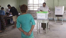 A man casts his vote in a by-election in a polling station in Dagon Seikkan township,  Yangon