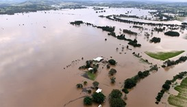 Australia floods still rising with two dead, four missing
