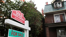 Ontario sets tax on foreign buyers to cool housing market