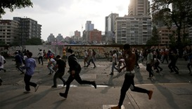 Opposition demonstrators clash with riot police