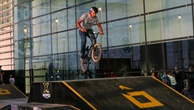 A BMX biker taking off from the platform.