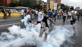 Demonstrators clash with the riot police during a protest against Venezuelan President Nicolas Madur