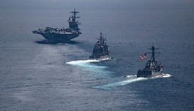 Aircraft carrier USS Carl Vinson (L) in the Indian Ocean