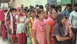 People queue up at a polling booth to cast their votes in New Delhi yesterday.
