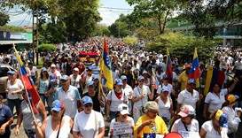 Venezuelan opposition activists march in a quiet show of condemnation of the government of President