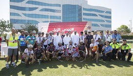 Qatar Rail officials with cyclists at the closing ceremony.